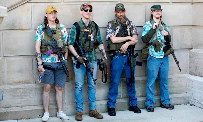 """<span class=""""element-image__caption"""">Armed protesters outside the Michigan state capitol in Michigan during 'Operation Haircut' in Lansing on 20 May.</span> <span class=""""element-image__credit"""">Photograph: Jeff Kowalsky/AFP/Getty Images</span>"""
