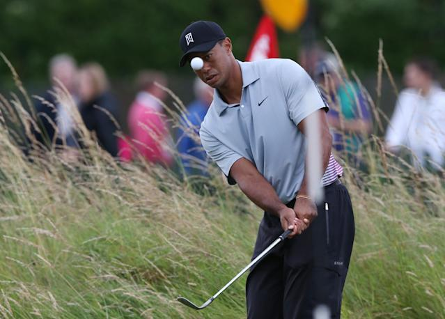 Tiger Woods of the US watches his shot on the practice chipping green ahead of the British Open Golf championship at the Royal Liverpool golf club, Hoylake, England, Wednesday July 16, 2014. The British Open Golf championship starts Thursday July 17. (AP Photo/Jon Super)