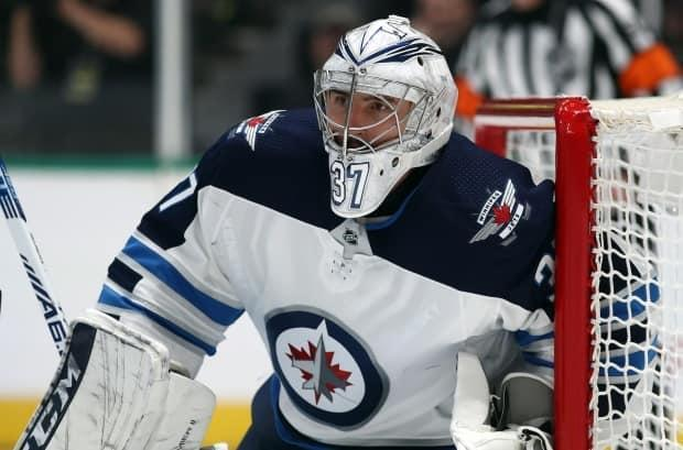 Jets goaltender Connor Hellebuyck says he's ready for the 2021-22 season after recovering from a COVID-19 infection he got in August while unvaccinated. (Ronald Martinez/Getty Images - image credit)