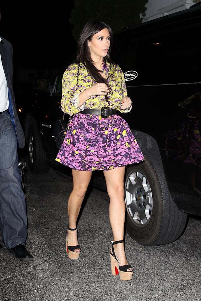 "Paris' former bestie Kim Kardashian delivered her own fashion faux pas this week when she hit the streets of NYC in this seizure-inducing floral frock and painful-looking Louboutin wedge sandals. Jae Donnelly/<a href=""http://www.infdaily.com"" target=""new"">INFDaily.com</a> - September 28, 2011"
