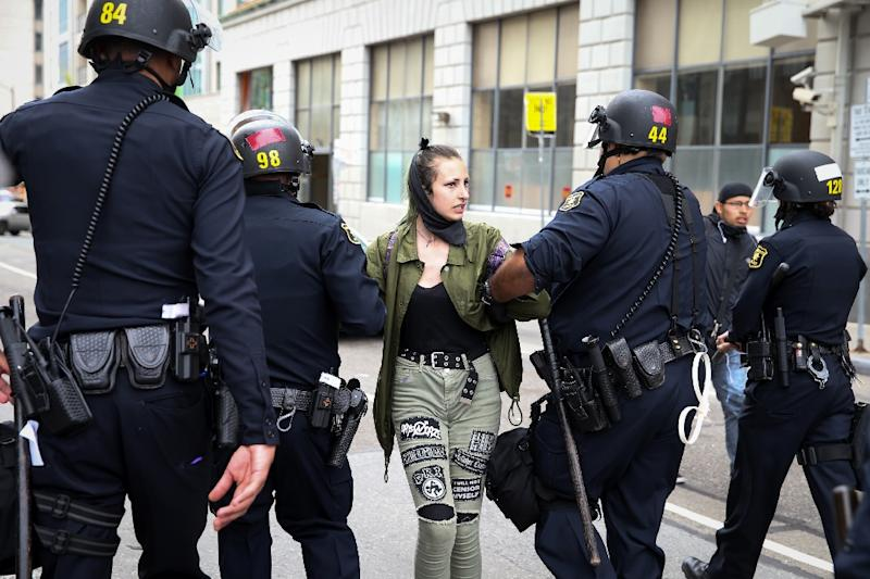 A protester is arrested following a 'Patriots Day' free speech rally in Berkeley, California, on April 15, 2017