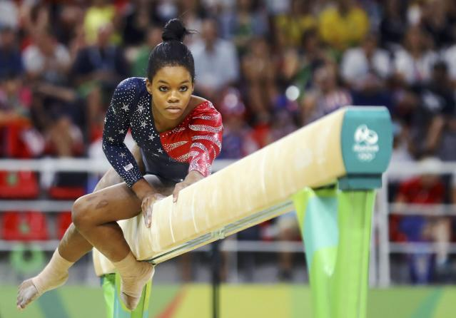 2016 Rio Olympics - Artistic Gymnastics - Preliminary - Women's Qualification - Subdivisions - Rio Olympic Arena - Rio de Janeiro, Brazil - 07/08/2016. Gabrielle Douglas (USA) of USA (Gabby Douglas) competes on the beam during the women's qualifications. REUTERS/Mike BlakeFOR EDITORIAL USE ONLY. NOT FOR SALE FOR MARKETING OR ADVERTISING CAMPAIGNS.