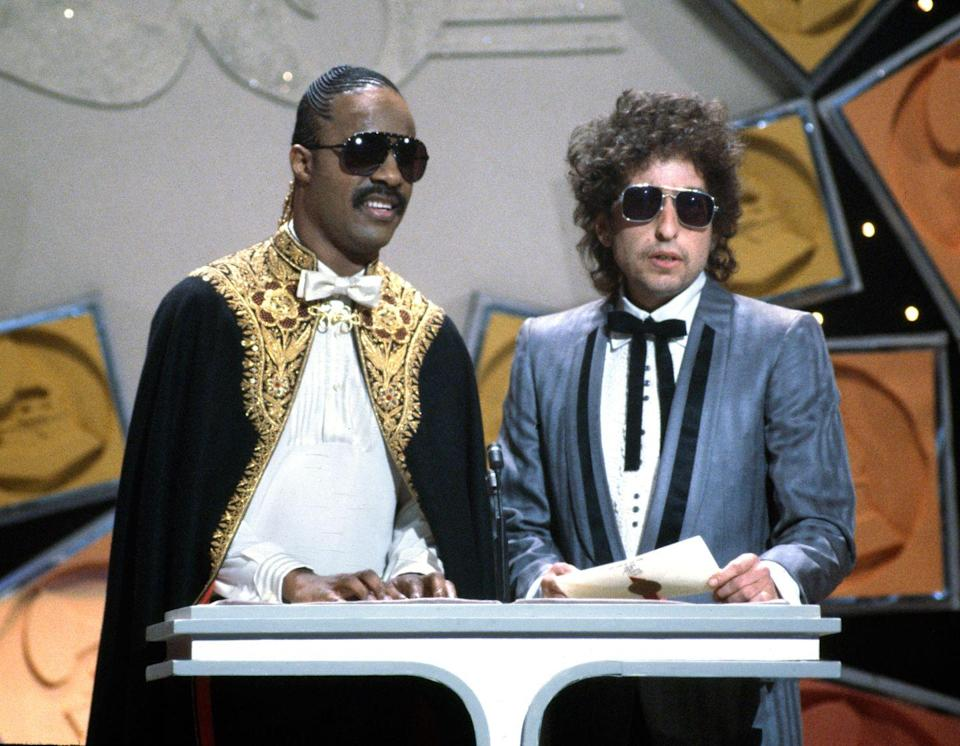 <p>Stevie Wonder and Bob Dylan attend the 26th Annual Grammy Awards on February 28, 1984. </p>