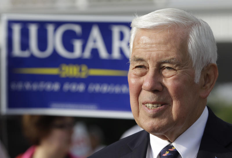 Sen. Richard Lugar meets with voters outside of a polling location Tuesday, May 8, 2012, in Greenwood, Ind. Lugar is being challenged by two-term state Treasurer Richard Mourdock. (AP Photo/Darron Cummings)