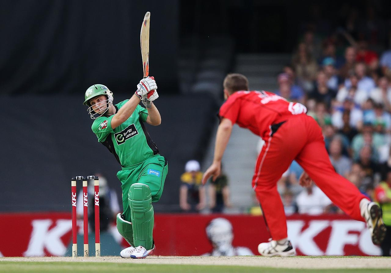MELBOURNE, AUSTRALIA - DECEMBER 07:  Luke Wright of The Stars hits the ball against Nathan Rimmington of The Renegades during the Big Bash League match between the Melbourne Renegades and the Melbourne Stars at Etihad Stadium on December 7, 2012 in Melbourne, Australia.  (Photo by Michael Dodge/Getty Images)