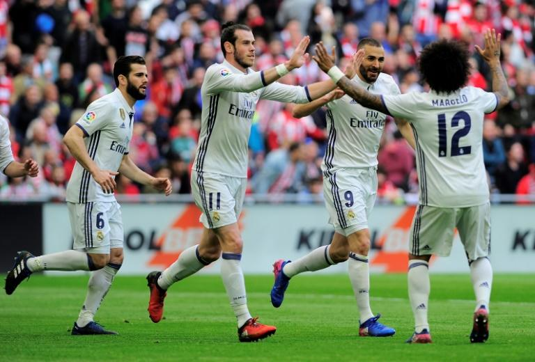 Real Madrid's players celebrate after forward Karim Benzema (2R) scored their team's first goal during the Spanish league football match against Athletic Club Bilbao 18, 2017