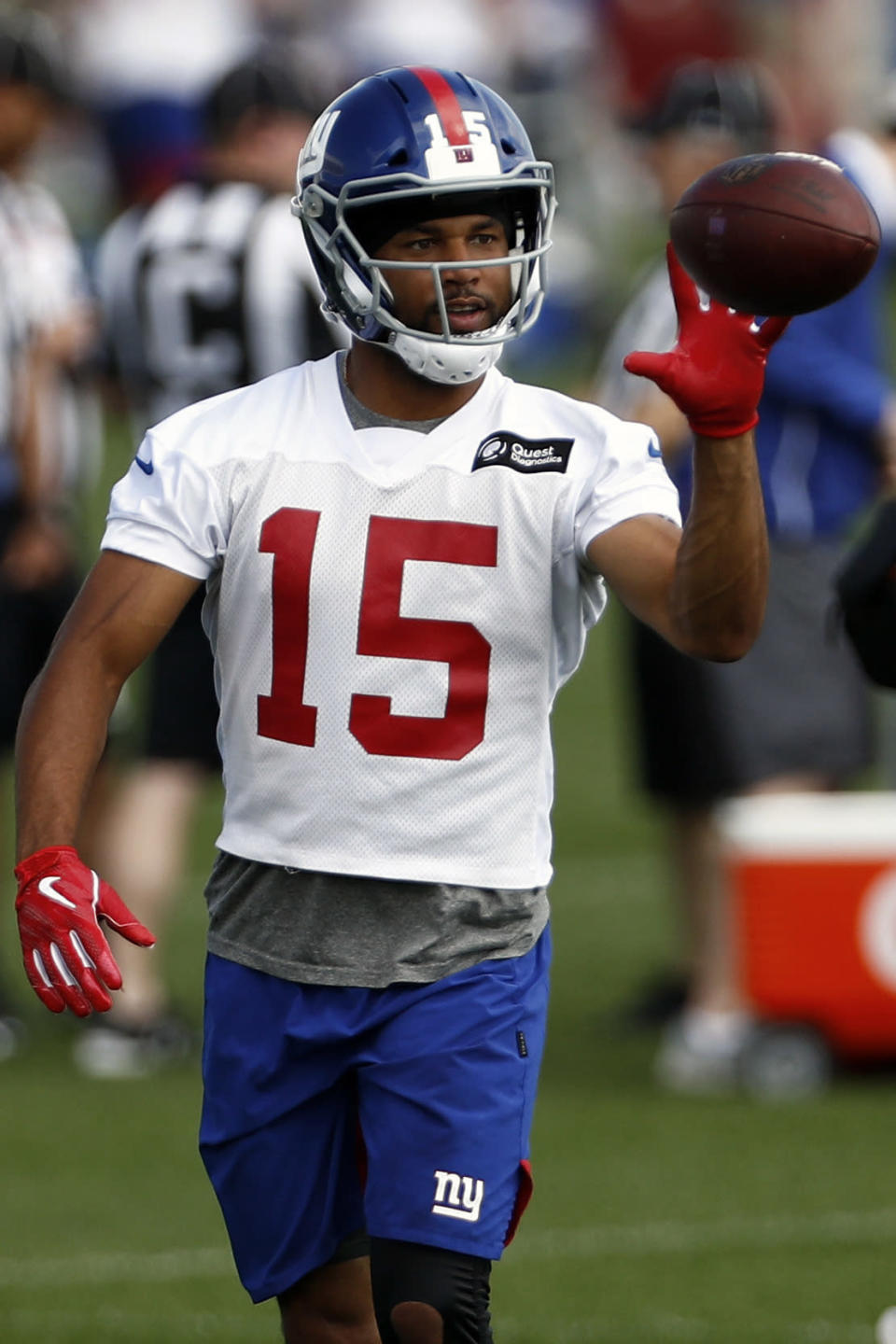 FILE - In this May 20, 2019, file photo, New York Giants wide receiver Golden Tate makes a catch during an NFL football practice in East Rutherford, N.J. Golden Tate has had the appeal of his four-game suspension for a violation of the NFL's policy on performance enhancers turned down. The decision by an independent arbiter was announced Tuesday, Aug. 13, 2019, and means the 10-year-veteran will miss the first four games of the regular season, starting with Dallas on Sept. 8. (AP Photo/Adam Hunger, File)