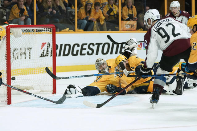 Colorado Avalanche left wing Gabriel Landeskog (92), of Sweden, fires a shot past Nashville Predators goalie Pekka Rinne (35), of Finland, to tie score during the third period in Game 5 of an NHL hockey first-round playoff series Friday, April 20, 2018, in Nashville, Tenn. The Avalanche won 2-1. (AP Photo/Sanford Myers)