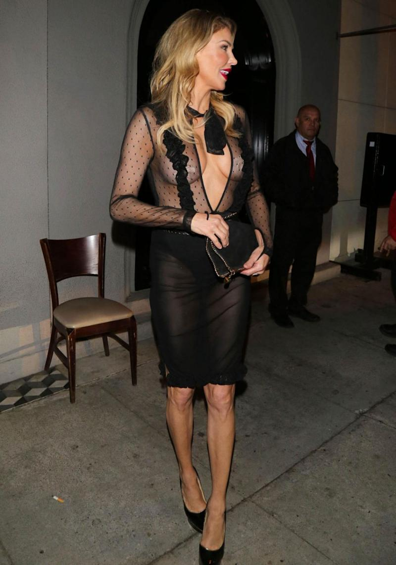 The media personality teamed her barely-there frock with a pair of black shoes and a matching clutch. Source: Getty