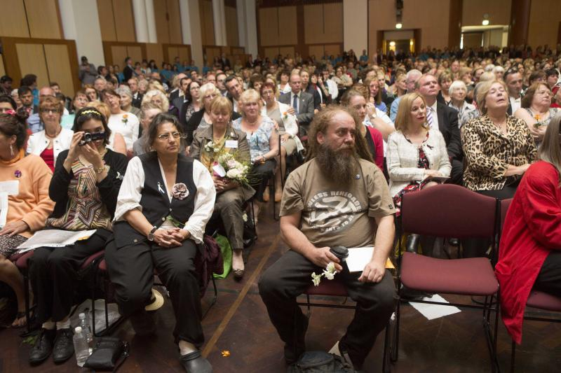 In this photo provided by the Attorney-General's Department, some of the audience made up of people affected by forced adoption policies, react during a national apology during a ceremony at Parliament House in Canberra, Thursday, March 21, 2013. Australian Prime Minister Julie Gillard delivered a historic national apology in Parliament on Thursday to the thousands of unwed mothers who were forced by government policies to give up their babies for adoption over several decades. (AP Photo/Attorney-General's Department, Andrew Taylor) EDITORIAL USE ONLY
