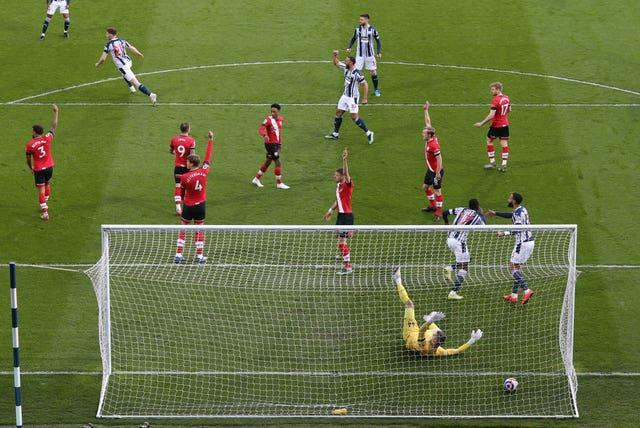 West Brom's Mbaye Diagne celebrates before having the goal ruled out for offside