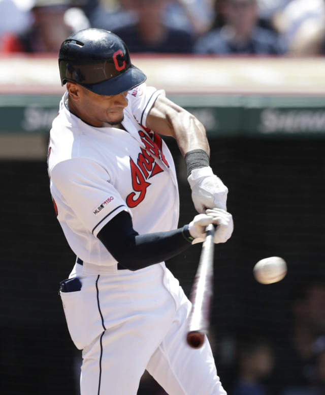 Cleveland Indians' Oscar Mercado hits an RBI-single in the sixth inning of a baseball game against the Kansas City Royals, Sunday, July 21, 2019, in Cleveland. Kevin Plawecki scored on the play. (AP Photo/Tony Dejak)