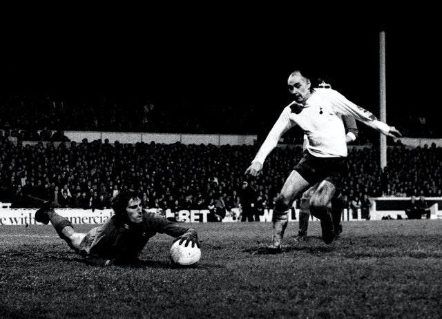 Ray Clemence dives at the feet of Tottenham's Alan Gilzean