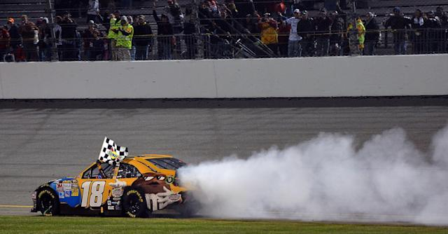 RICHMOND, VA - APRIL 28: Kyle Busch, driver of the #18 M&M's Ms. Brown Toyota, celebrates with a burnout after winning the NASCAR Sprint Cup Series Capital City 400 at Richmond International Raceway on April 28, 2012 in Richmond, Virginia. (Photo by Drew Hallowell/Getty Images)