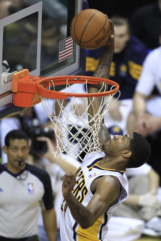 Indiana Pacers' Paul George dunks during the first half of an NBA first-round playoff basketball game against the Orlando Magic on Monday, April 30, 2012, in Indianapolis. (AP Photo/Darron Cummings)