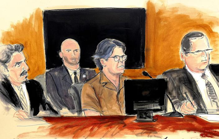 In this courtroom sketch Keith Raniere, second from right, leader of the secretive group NXIVM, attends a court hearing Friday, April 13, 2018.