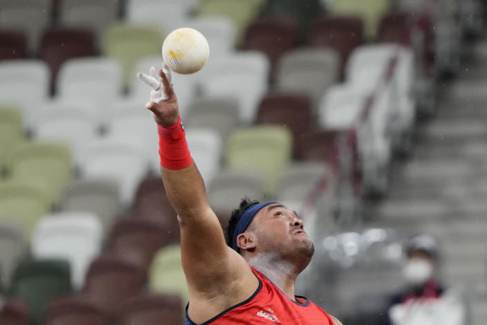 FILE - In this Tuesday, Aug. 31, 2021, file photo, Muhammad Ziyad Zolkefli of Malaysia competes in the men's shot put F20 final during the Tokyo 2020 Paralympics Games at the National Stadium in Tokyo, Japan. Zolkefli appeared to have won gold in the shot put in the F20 class. But after the victory on Tuesday, he was disqualified because he had shown up late for the competition. (AP Photo/Eugene Hoshiko, File)