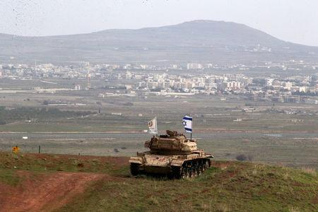 An old military vehicle can be seen positioned on the Israeli side of the border with Syria, near the Druze village of Majdal Shams in the Israeli-occupied Golan Heights