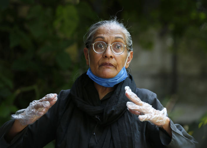 Tahira Abdullah, a human rights activist, speaks during an interview with The Associated Press, in Islamabad, Pakistan, Saturday, July 11, 2020. Abdullah has courted the wrath of extremists by championing the country's minorities, marching for their rights and women's rights. Analysts and activists say minorities in Pakistan are increasingly vulnerable to Islamic extremists as Prime Minister Imran Khan vacillates between trying to forge a pluralistic nation and his conservative Islamic beliefs. (AP Photo/Anjum Naveed)