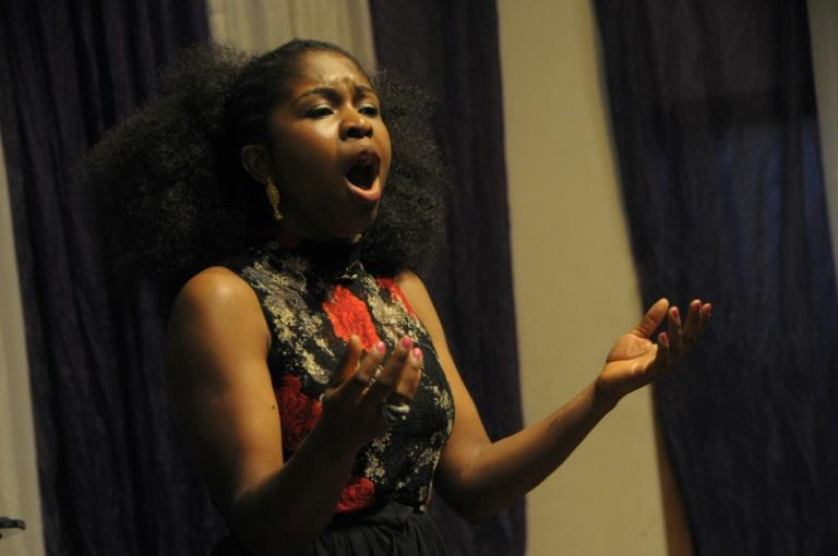 Nigerian soprano Omo Bello, her fame growing round the world, brings an aria by Italian composer Puccini to a Lagos rehearsal attended by a curious crowd