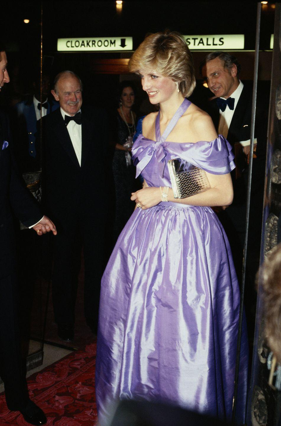 <p>Princess Diana's off-the-shoulder gown mimics Rapunzel's silhouette with a fitted bodice and full skirt. The Princess wore the taffeta Donald Campbell ball gown to the theater in 1982. </p>