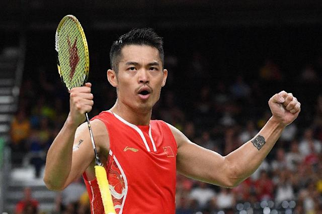 China's Lin Dan (R) reacts after winning against India's Srikanth Kidambi during their men's singles quarter-final badminton match on August 17, 2016 (AFP Photo/Goh Chai Hin)
