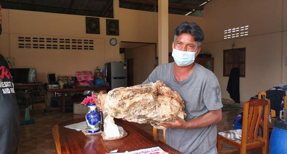 Narong Phetcharaj posing with the ambergris whale vomit.