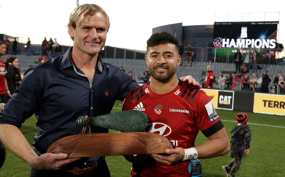 Crusaders coach Scott Robertson, left, and Richie Mo'unga pose with their trophy after the Super Rugby Aotearoa rugby game between the Crusaders and the Highlanders in Christchurch, New Zealand, Sunday, Aug. 9, 2020 - AP