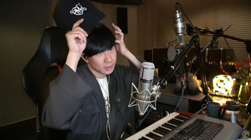 JJ Lin is seen taking off his cap from time to time to style his bangs. (Screenshot from the video)