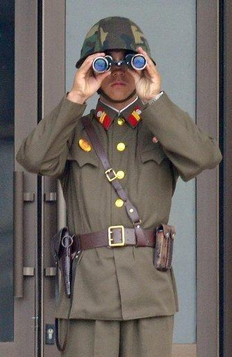A North Korean soldier at the truce village of Panmunjom in the demilitarized zone that separates the two Koreas. North Korea's new leadership has agreed to suspend nuclear tests and its uranium enrichment programme as part of a deal that includes US food aid for the impoverished nation