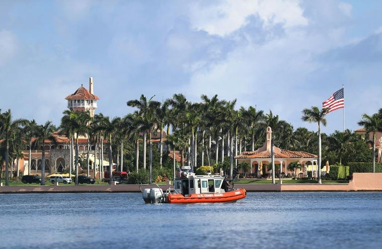 A US Coast Guard boat passes in front of Donald Trump's Mar-a-Lago estate, where the new US president has conducted important affairs of state