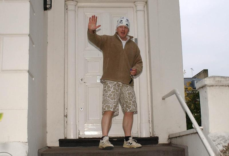 Johnson, in his trademark early morning jogging gear, outside his London home in 2004. (PA)