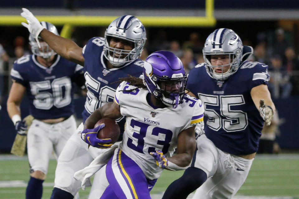 Minnesota Vikings running back Dalvin Cook (33) runs the ball as Dallas Cowboys' Robert Quinn (58) and Leighton Vander Esch (55) give chase during the first half of an NFL football game in Arlington, Texas, Sunday, Nov. 10, 2019. (AP Photo/Michael Ainsworth)