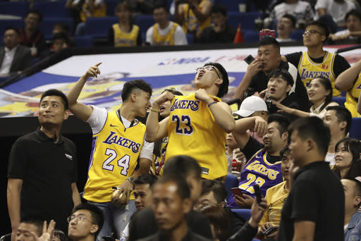FILE - In this file photo taken Oct. 10, 2019, Chinese fans react during a preseason NBA basketball game between the Brooklyn Nets and Los Angeles Lakers at the Mercedes Benz Arena in Shanghai, China. CCTV announced Friday, Oct. 9, 2020 that it would air Game 5 of the NBA Finals between the Los Angeles Lakers and Miami Heat the first time that the league would appear on the network since the rift that started when Houston Rockets general manager Daryl Morey tweeted support for anti-government protesters in Hong Kong. (AP Photo, File)