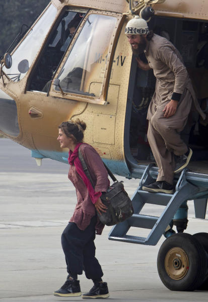 Swiss couple David Och and Daniela Widmer, left, get out from a helicopter at Qasim military base in Rawalpindi, Pakistan on Thursday, March 15, 2012. A Swiss couple held captive for nearly a year by the Taliban in Pakistan turned up at an army post close to the Afghan border on Thursday, claiming to have escaped from their captors, the Pakistani army said. They were swiftly flown to safety by the military. (AP Photo/B.K. Bangash)