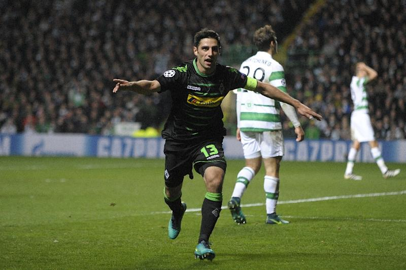 Monchengladbach's midfielder Lars Stindl celebrates scoring his team's first goal during the UEFA Champions League Group C football match between Celtic and Borussia Monchengladbach at Celtic Park stadium in Glasgow, Scotland on October 19, 2016 (AFP Photo/Andy Buchanan                       )