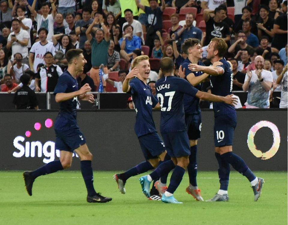 Tottenham Hotspur players congratulate Harry Kane (right) after the striker scored the winning goal in their International Champions Cup match against Juventus at the National Stadium