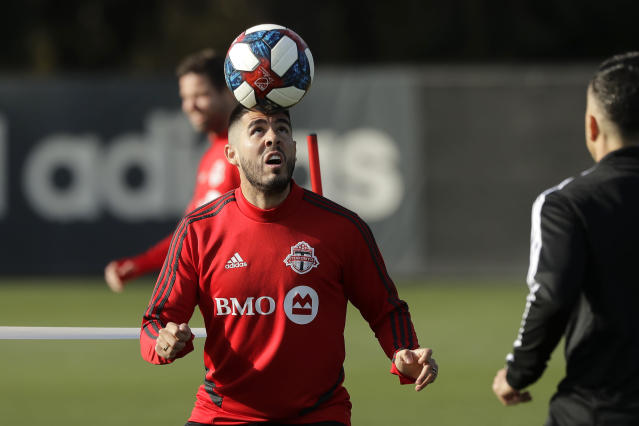 Toronto FC midfielder Alejandro Pozuelo heads the ball during a training session Friday, Nov. 8, 2019, in Tukwila, Wash. Toronto FC will face the Seattle Sounders on Sunday in the MLS Cup soccer match at CenturyLink Field in Seattle, the third time the two teams will have met for the MLS championship. (AP Photo/Ted S. Warren)
