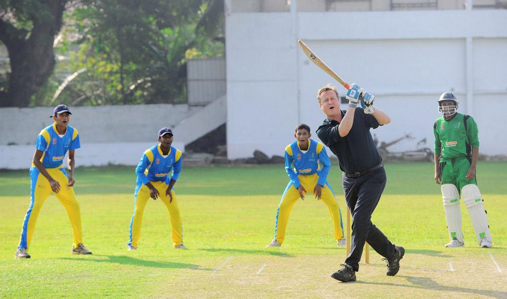In this handout photo provided by Sri Lankan Government, British Prime Minister David Cameron attempts to bat a ball during his visit to the Colombo Cricket Club on November 16, 2013 in Colombo, Sri Lanka. (Photo by Sri Lankan Government/Getty Images)