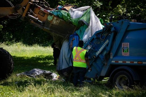The last remaining tents and a tiny home are removed from an encampment in Trinity Bellwoods Park, in Toronto, on Jun. 23, 2021. (Evan Mitsui/CBC - image credit)