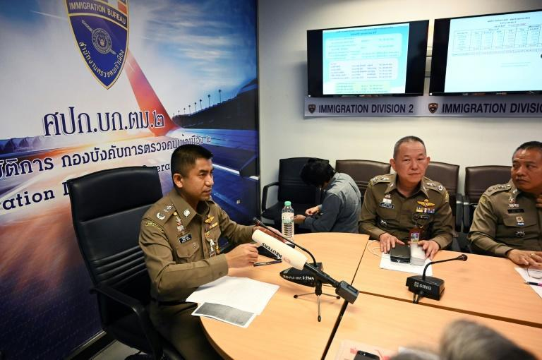 Thai immigration chief Surachet Hakparn (L) made an abrupt about-face more than 24 hours after Qunun landed