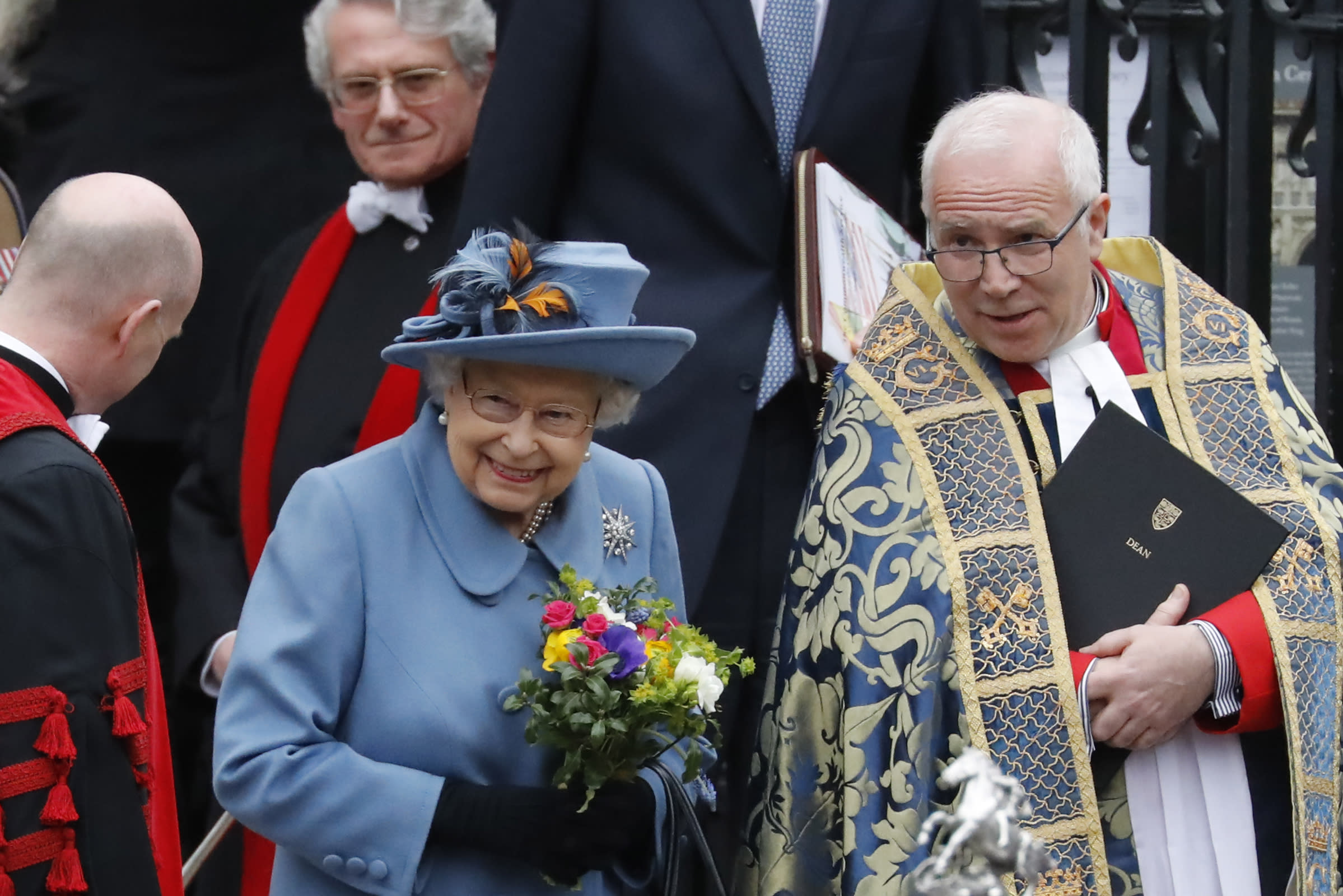 Britain's Queen Elizabeth II (L) and The Very Reverend Dr David Hoyle, Dean of Westminster leave after attending the annual Commonwealth Service at Westminster Abbey in London on March 09, 2020. - Britain's Queen Elizabeth II has been the Head of the Commonwealth throughout her reign. Organised by the Royal Commonwealth Society, the Service is the largest annual inter-faith gathering in the United Kingdom. (Photo by Tolga AKMEN / AFP) (Photo by TOLGA AKMEN/AFP via Getty Images)