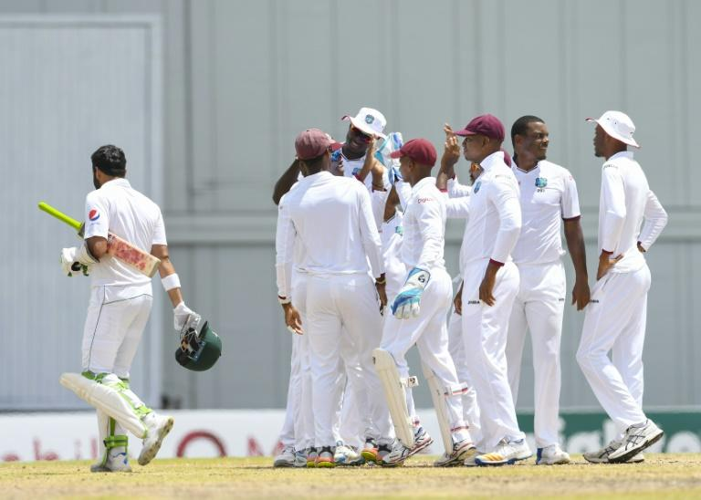 Azhar Ali (L) of Pakistan is dismissed as Shannon Gabriel (2R) of West Indies celebrates with teammates during the 5th and final day of their 2nd Test match at Kensington Oval, Bridgetown, Barbados, May 04, 2017