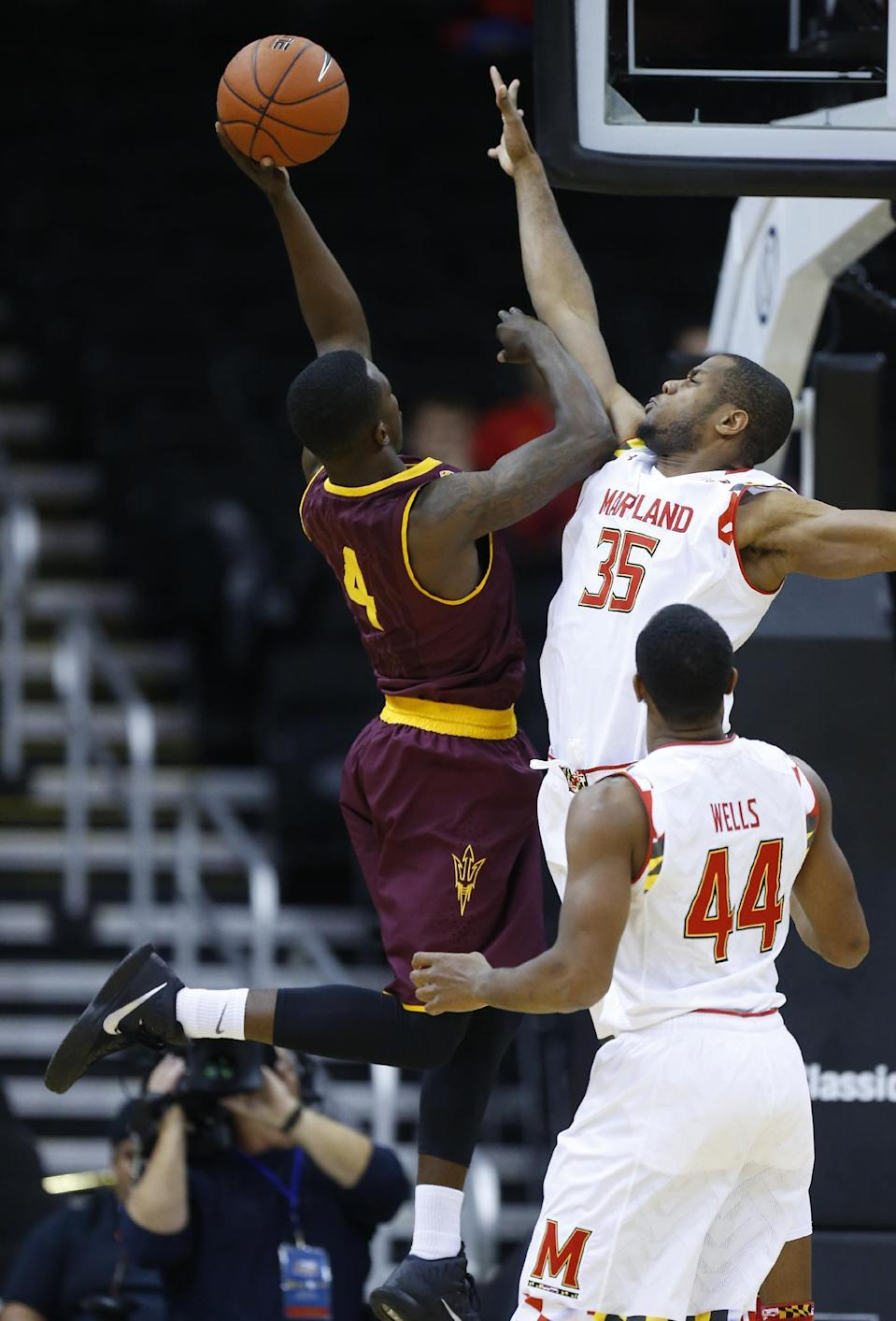 Arizona State guard Gerry Blakes (4) takes a shot over Maryland forward Damonte Dodd (35) as Dez Wells (44) looks on in the first half of the CBE Hall of Fame Classic college baseball game Monday, Nov. 24, 2014, in Kansas City, Mo. (AP Photo/Ed Zurga)
