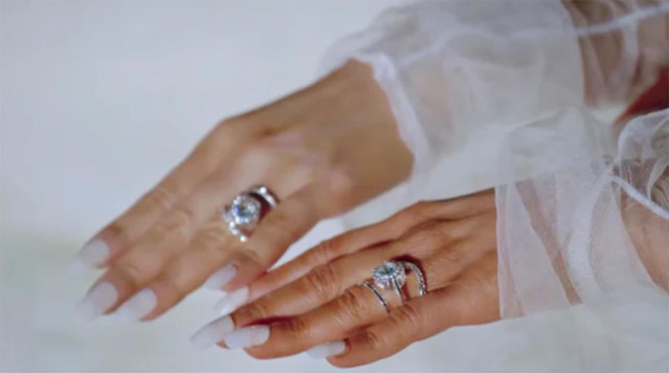 Close up shot of identical twins Anna and Lucy DeCinque's hands wearing matching diamond engagement rings