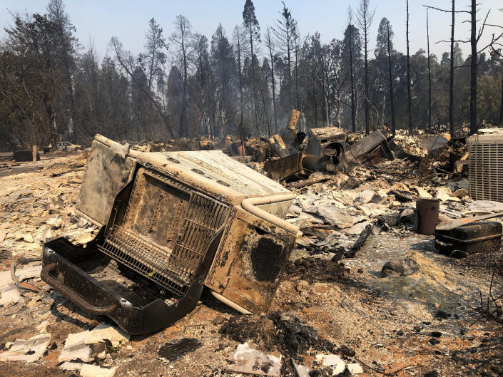 The ruins of homes destroyed by a wildfire litters the ground in Phoenix, Ore., Thursday, Sept. 10, 2020. (AP Photo/Gillian Flaccus)