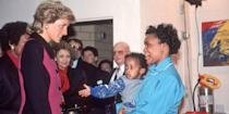 <p>Diana speaks to a woman and child while visiting a day care center in the Lower East Side. </p>