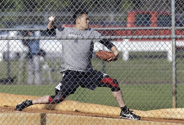 New York Yankees pitcher Masahiro Tanaka, of Japan, throws in the bullpen during practice at the Yankees' minor league facility Thursday, Feb. 13, 2014, in Tampa, Fla. (AP Photo/Chris O'Meara)