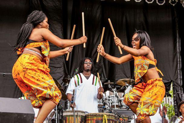 PHOTO: Members of the Sankofa Dance & Drum Team perform at Point State Park for the Western Pennsylvania Juneteenth Celebration on June 18, 2021, in Pittsburgh, Pa.  (Sarah Simpson/Pittsburgh Post-Gazette via AP)
