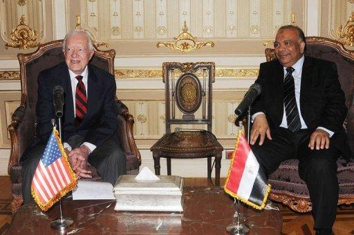 Egyptian Parliament Speaker Saad al-Katatni (R) meets withs former US president Jimmy Carter in his office in Cairo. Carter had arrived on Sunday with a delegation from his Carter Center to monitor the polls